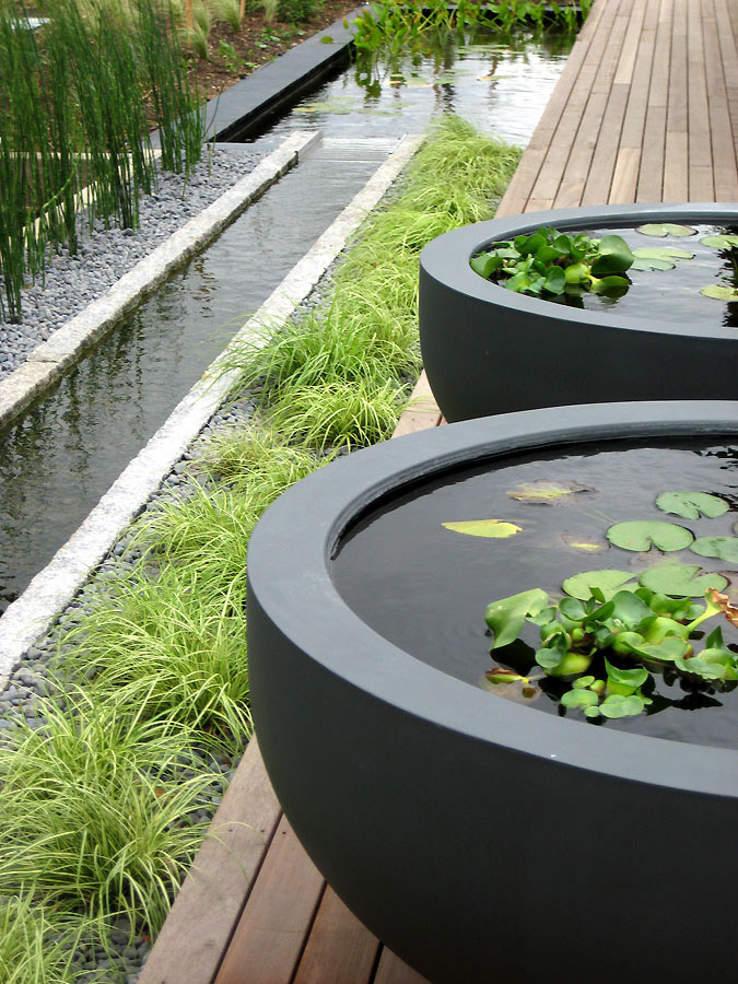 Water rill and freestanding water bowls. Rae Wilkinson Garden and Landscape Design - Garden Designer Sussex, Surrey, London, South-East England
