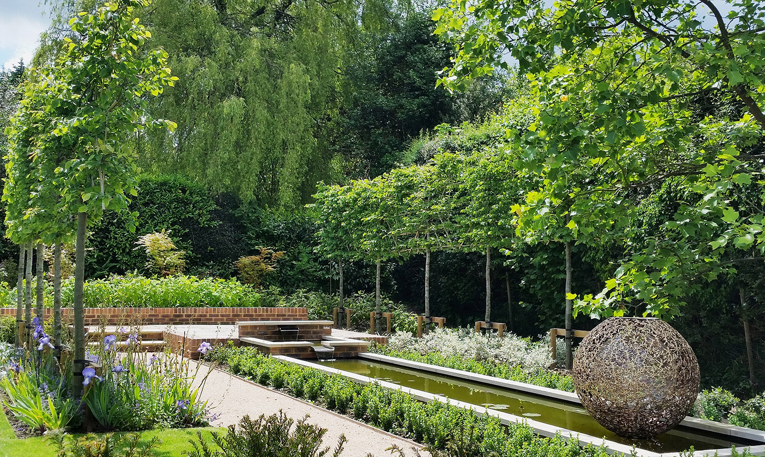 View of classic, modern garden design. Rae Wilkinson Garden and Landscape Design - Garden Designer Sussex, Surrey, London, South-East England