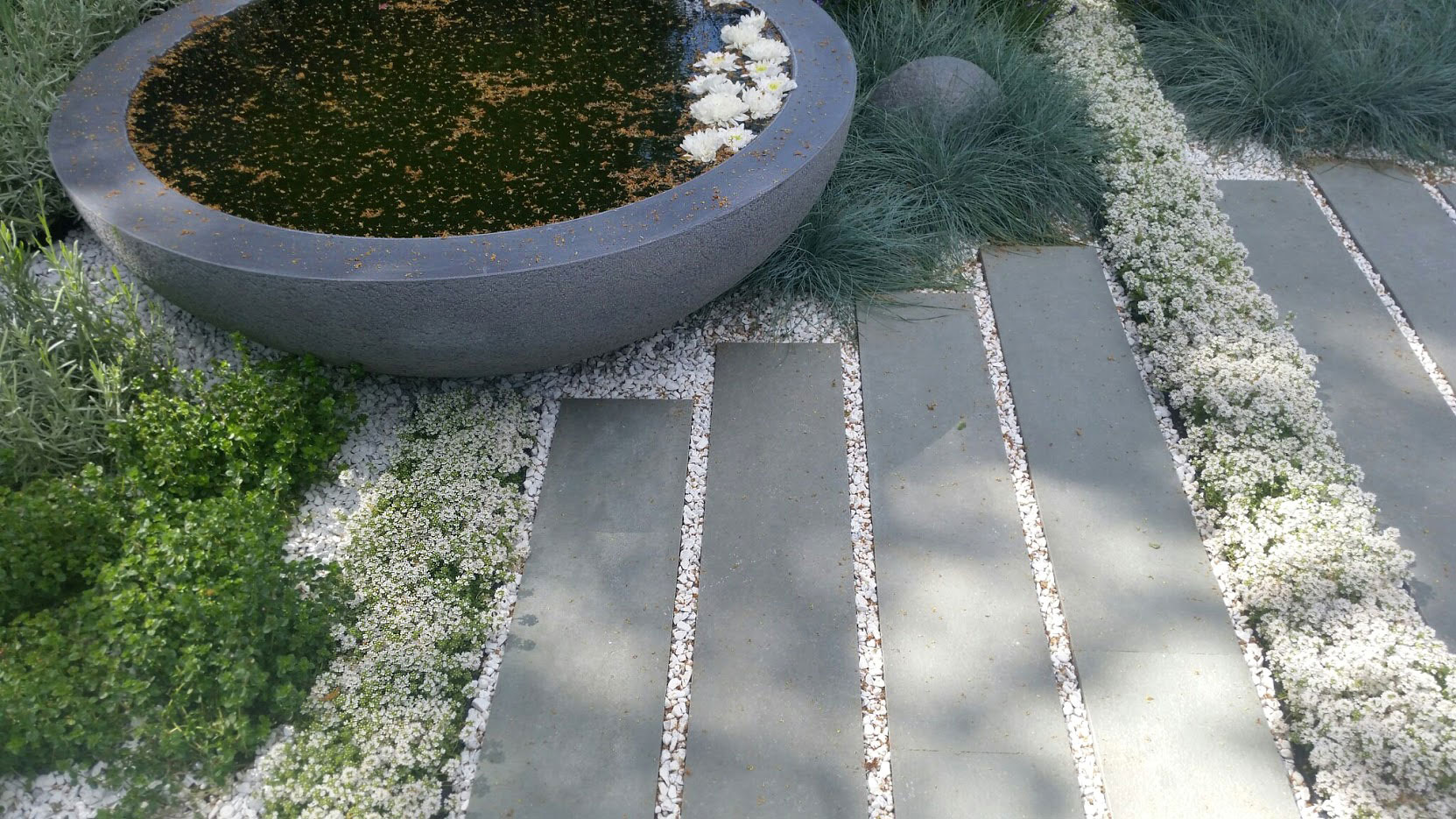 Detail of planter and paving in Rae Wilkinson's RHS Hampton Court Show Garden
